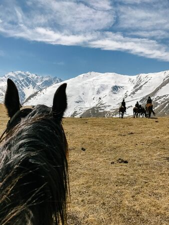 riding a horse first person view of the mountain and sky