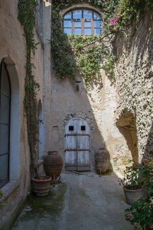 architecture and old buildings of Italy in the city of Ischia in the daytime Imagens