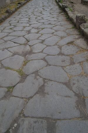 old hiking trail paved with stones in the daytime