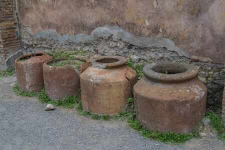 old and rusty barrels on the street covered with moss