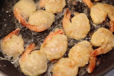 shrimp fried in a frying pan close-up