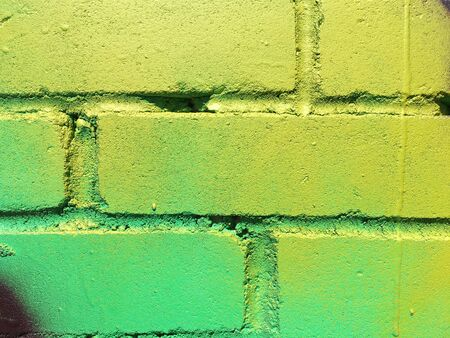 colorful paint on an old brick wall close up