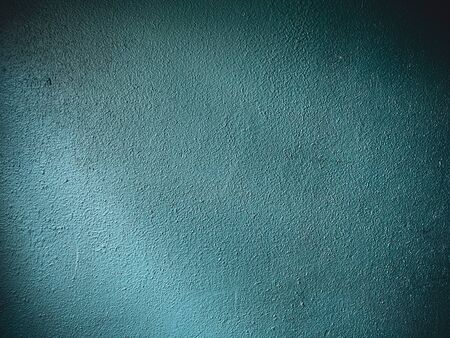 old rough dark blue-green wall background Banco de Imagens
