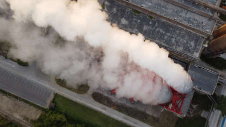 Air pollution by smoke coming out of factory chimneys. Birds-eye view of the industrial zone in the Leningrad region