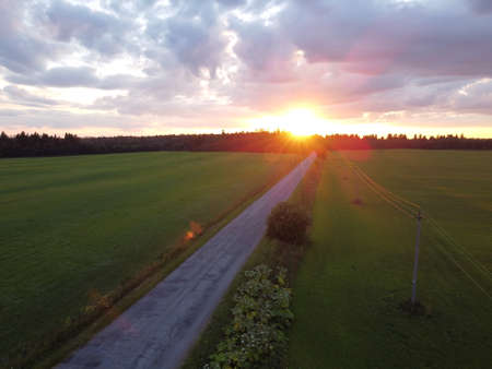 old car road at sunset in summer aerial photography
