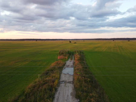 old car road at sunset in summer aerial photography.