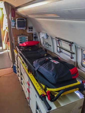 Zurich, Switzerland - November 11, 2018: Interior of Swiss Rega air ambulance and rescue airplane in service hangar at Zurich International Airport