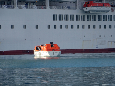Lifeboat of a cruise ship executing mandatory safety and assistance maneuvers