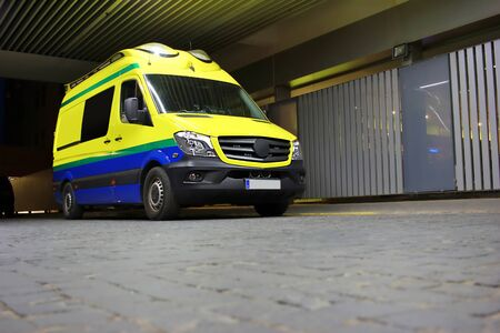 ambulance parked at the emergency door, waiting for an emergency call for intervention night scene