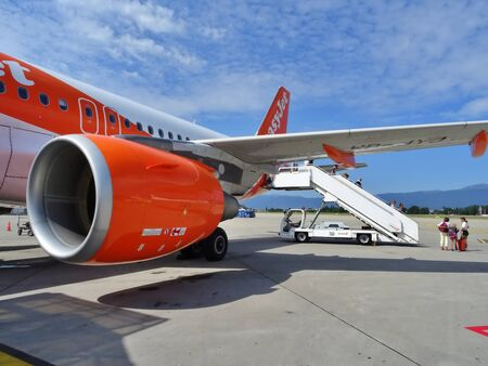 passengers disembarking from an easyjet flight. Passengers going down the stairs to the landing strip of the Geneva airport, Switzerland. Sajtókép