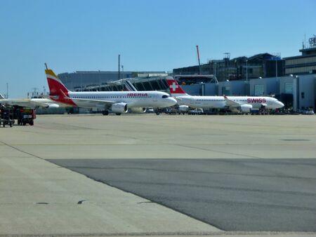 Iberia Aircraft on the runway of Geneva Airport, Switzerland. Passenger traffic in summer.