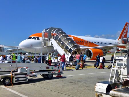 Easyjet Aircraft on the runway of Geneva Airport, Switzerland. Passenger traffic in summer. Sajtókép