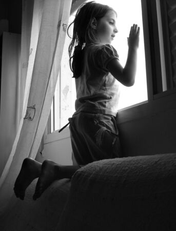 bw: Girl looking through the window
