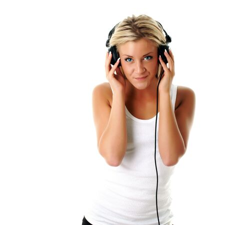 Female DJ with headphones and a sexy smile photo