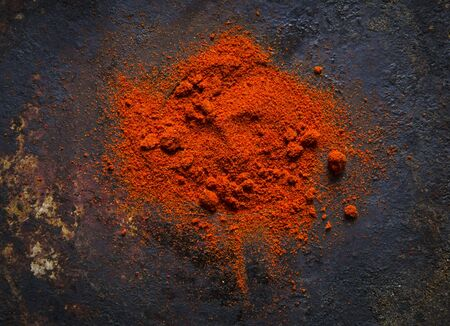 Red paprika powder on a black background Stock Photo