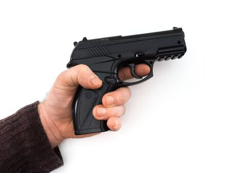 Black gun in a mans hand isolated on white background
