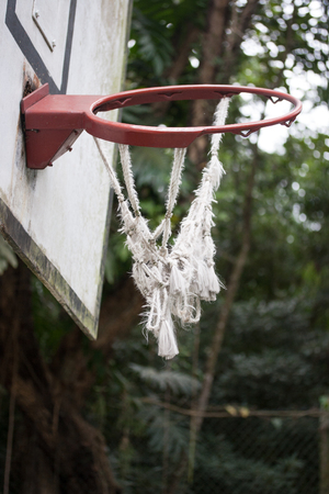 twisted: Broken and twisted basketball hoop on outdoor court