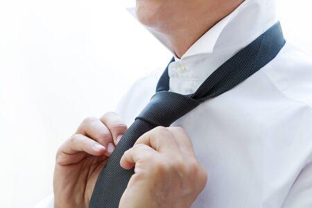 man who ties his tie Stock Photo - 17718781