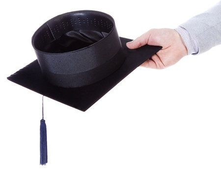 mortarboard academic graduation cap in the hand photo