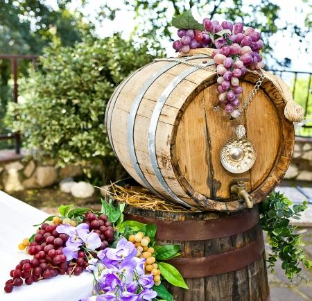 oak barrel: barrel of wine with grape cones Stock Photo