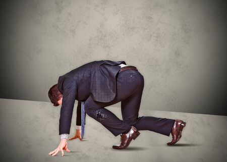 kneel down: business man runner competing work Stock Photo