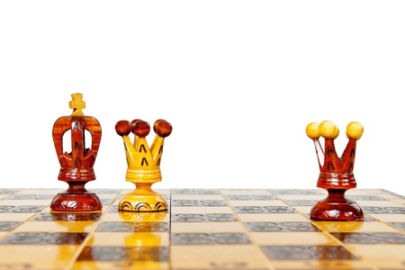 betray: black King betrays black Queen with white queen reflected on a chessboard Stock Photo