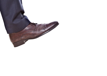 shoes off: business feet isoleted on a white background Stock Photo