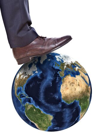 business feet on earth symbolizing the exploitation photo