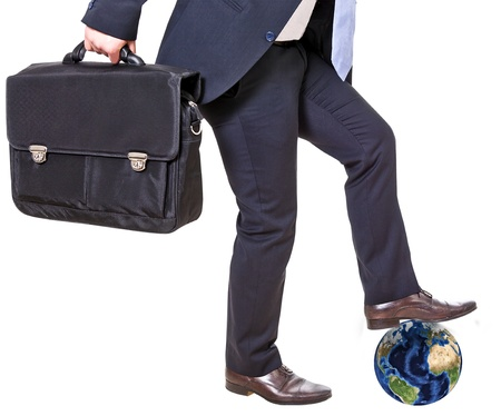 businessman crushes earth isolated on a white background photo