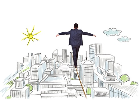 businessman balancing on tightrope city Stock Photo