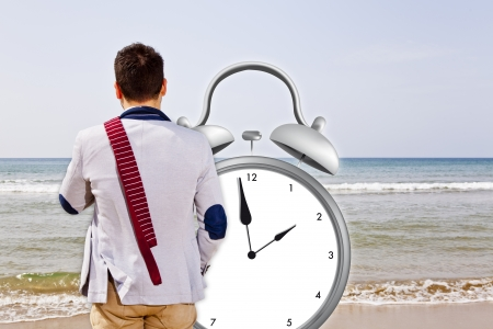 holiday time with big alarm clock on a sea background photo