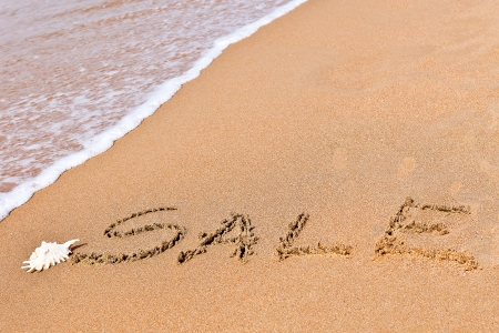 written sale drawn on the sand on the beach with shell Stock Photo - 20214206