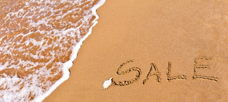 written sale drawn on the sand on the beach Stock Photo - 20214208