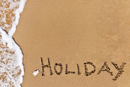 written holiday drawn on the sand on a beach Stock Photo - 20212952