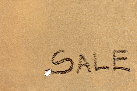 written sale drawn on the sand on the beach Stock Photo - 20212857