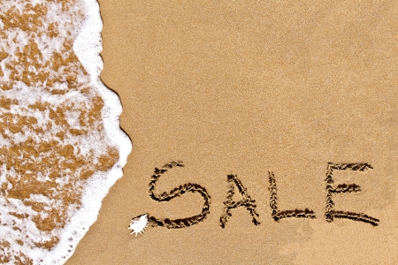 written sale drawn on the sand on the beach Stock Photo - 20212963