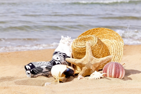 summer holiday accessories on a beach photo