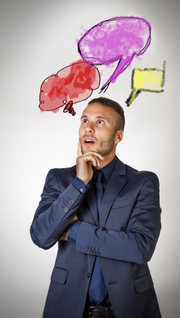 dismayed: thinking man with colored cloud and cartoon  Stock Photo