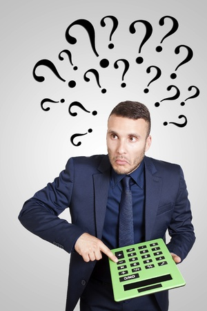 Bid: young businessman surprised with green calculator Stock Photo