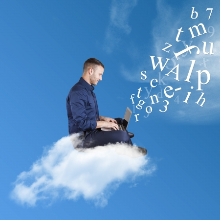 Businessman works over a cloud on a sky background Stock Photo