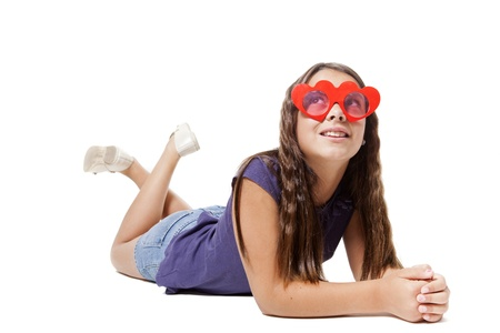 girl lying think about love with a pair of glasses heart shape photo