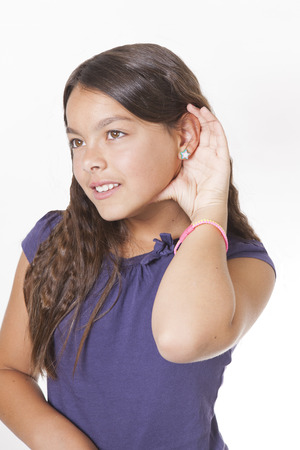 girl listening with hand to ear isolated on a white background photo