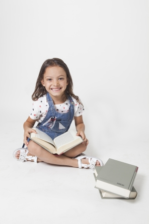 young student with textbook on a white background photo