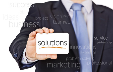 businessman offer solutions with a business card  Standard-Bild