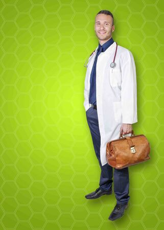 young Doctor isolated on a green background photo