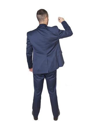 youmg businessman writing isolated on a white background photo