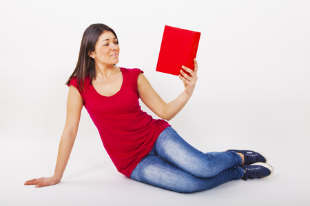 woman reading book with red t shirt photo