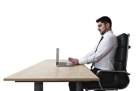 stressed businessman at work on a chair photo