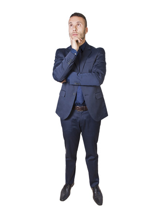 a young businessman thinking isolated on a white background photo