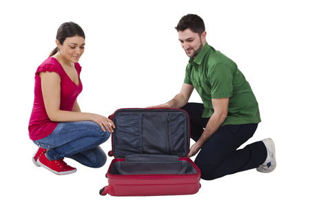 man and woman travelers with red suitecase photo